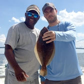 A pair of locals show off their catch from the deck of the Capitol Princess in New York Harbor.