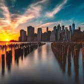 Sunset over Lower Manhattan skyline from Brooklyn Bridge Park