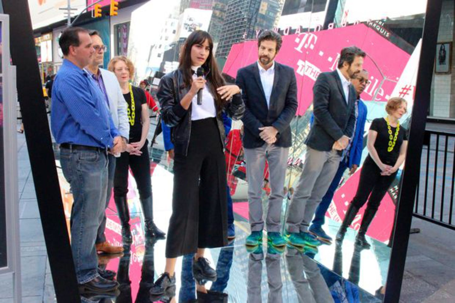 """Artist Rachel Valdés Camejo, Times Square Alliance President Tim Tompkins and Times Square Arts Director Sherry Dobbin unveil """"The Beginning of the End."""""""