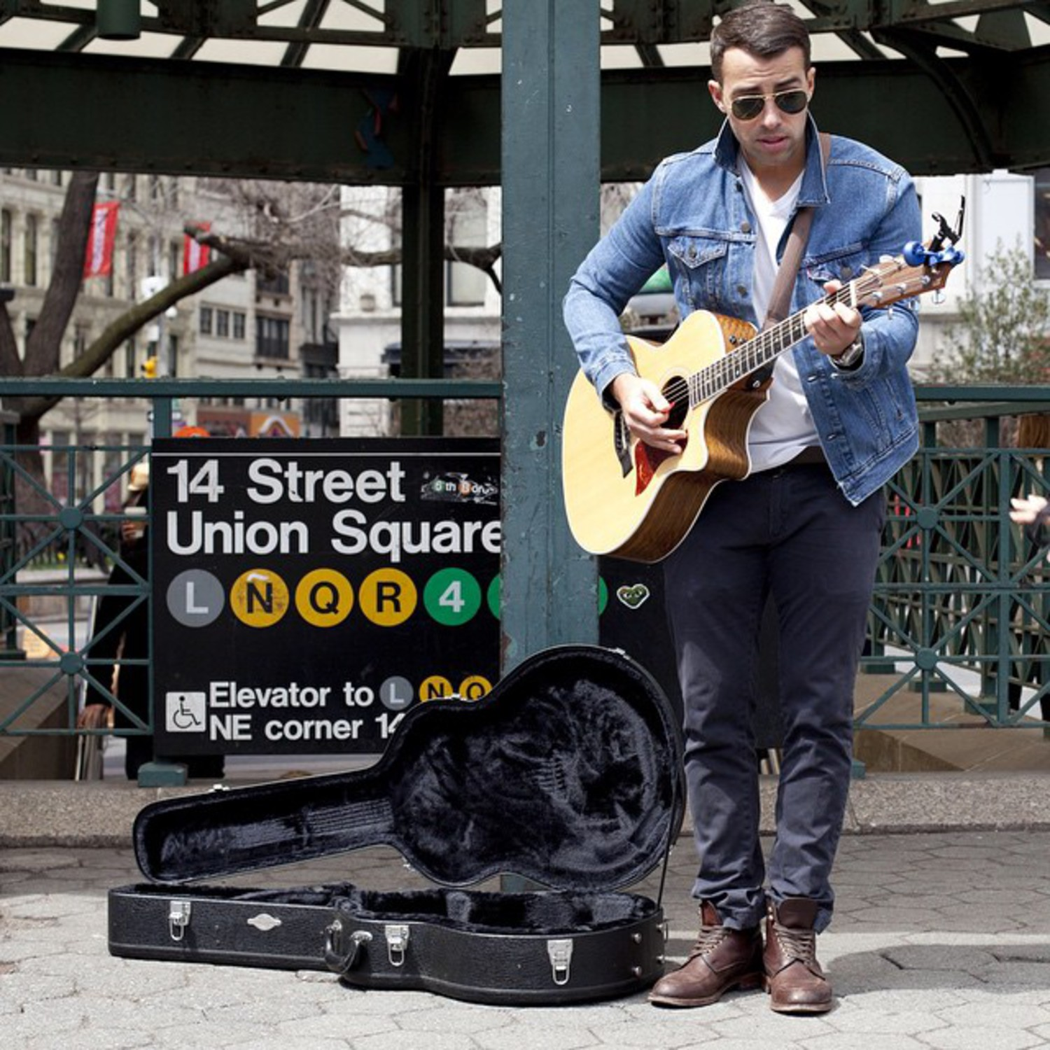 Chris Leamy busks to help the homeless