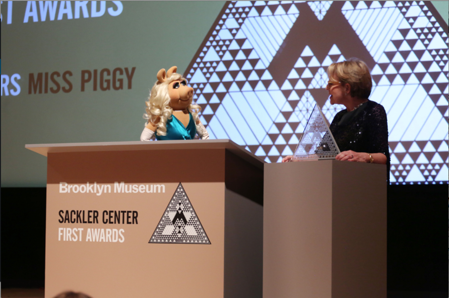 Miss Piggy accepts her award.