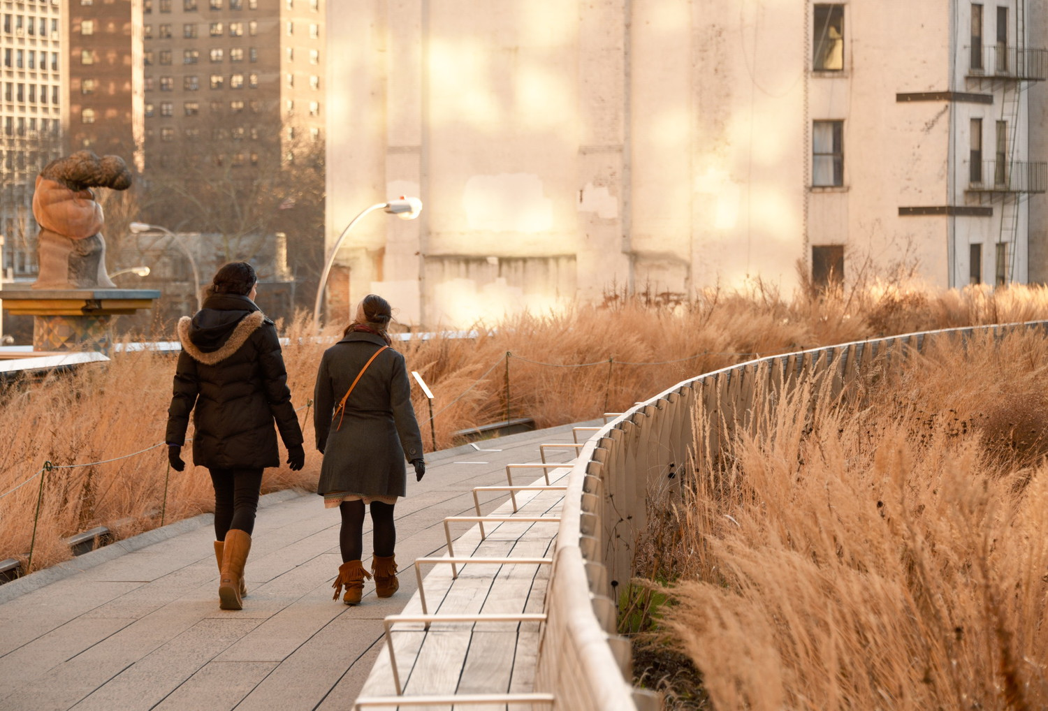 Radial Curve | A couple of visitors brave the cold and wind to stroll along the Radial Bench at the High Line.