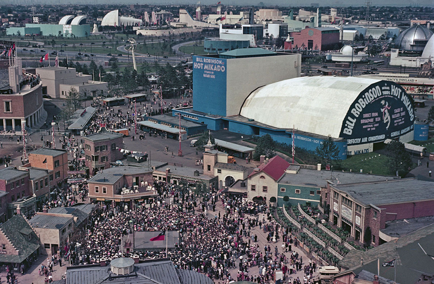 An aerial view of the fair shows the music hall advertising Hot Mikado with Bill Robinson.