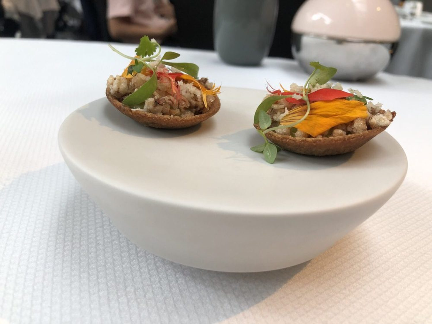 Amuse Bouche. Buckwheat tartlet with green tomatoes and horseradish.