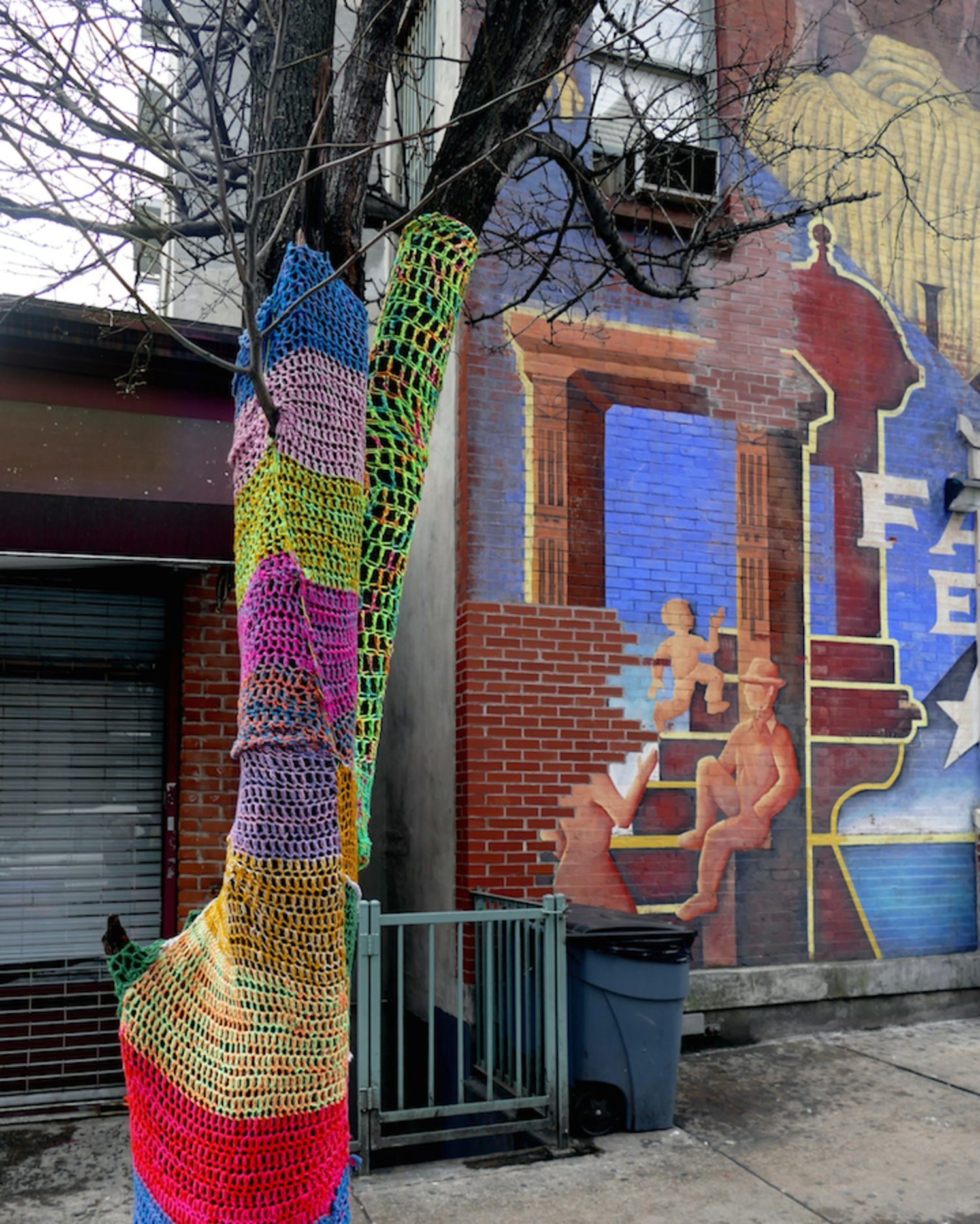 East Harlem resident Naomi RAG has continued to yarn bomb her neighborhood, enhancing it with color, warmth and intrigue.