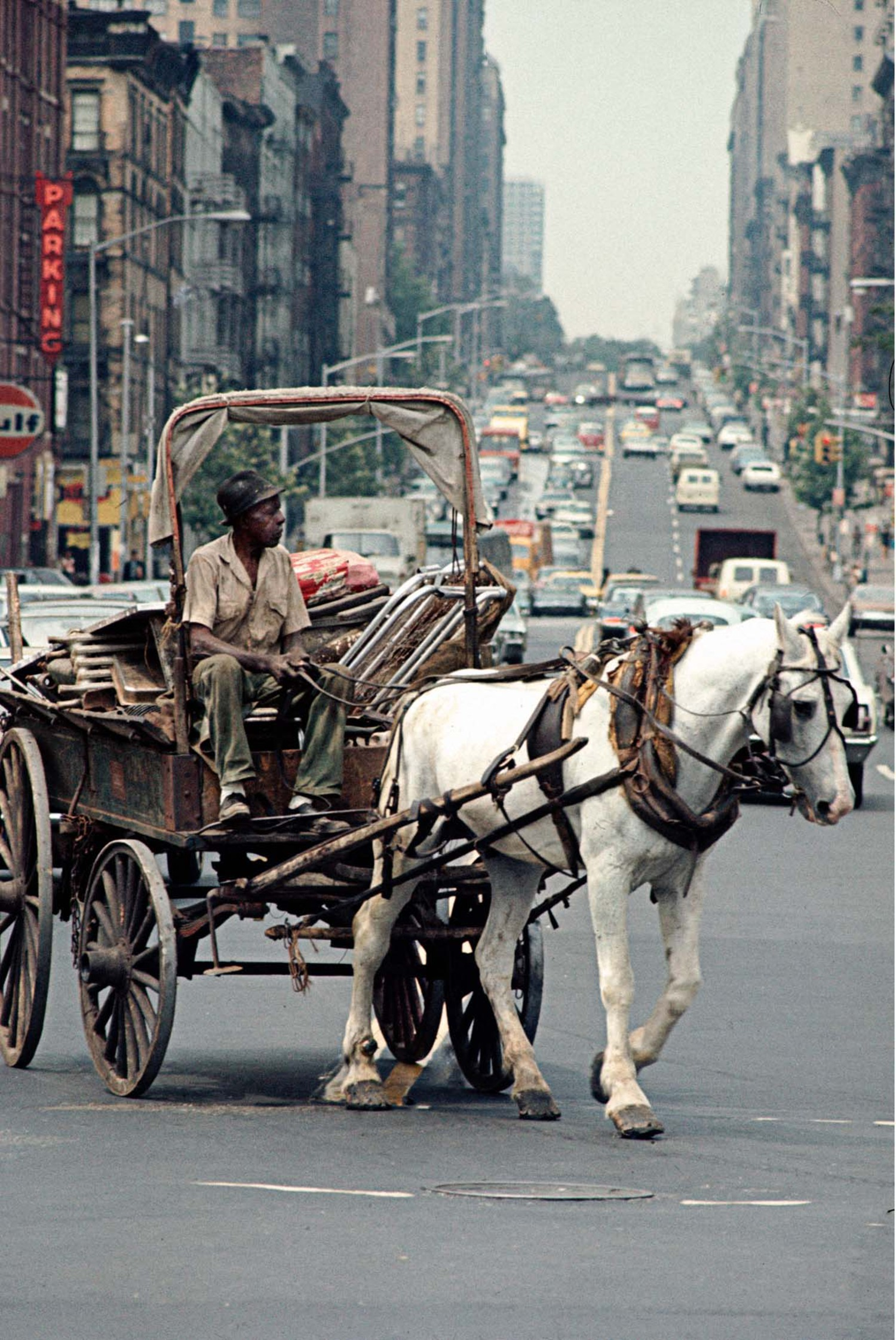 Scrap metal collector on the Way to Harlem, 1970