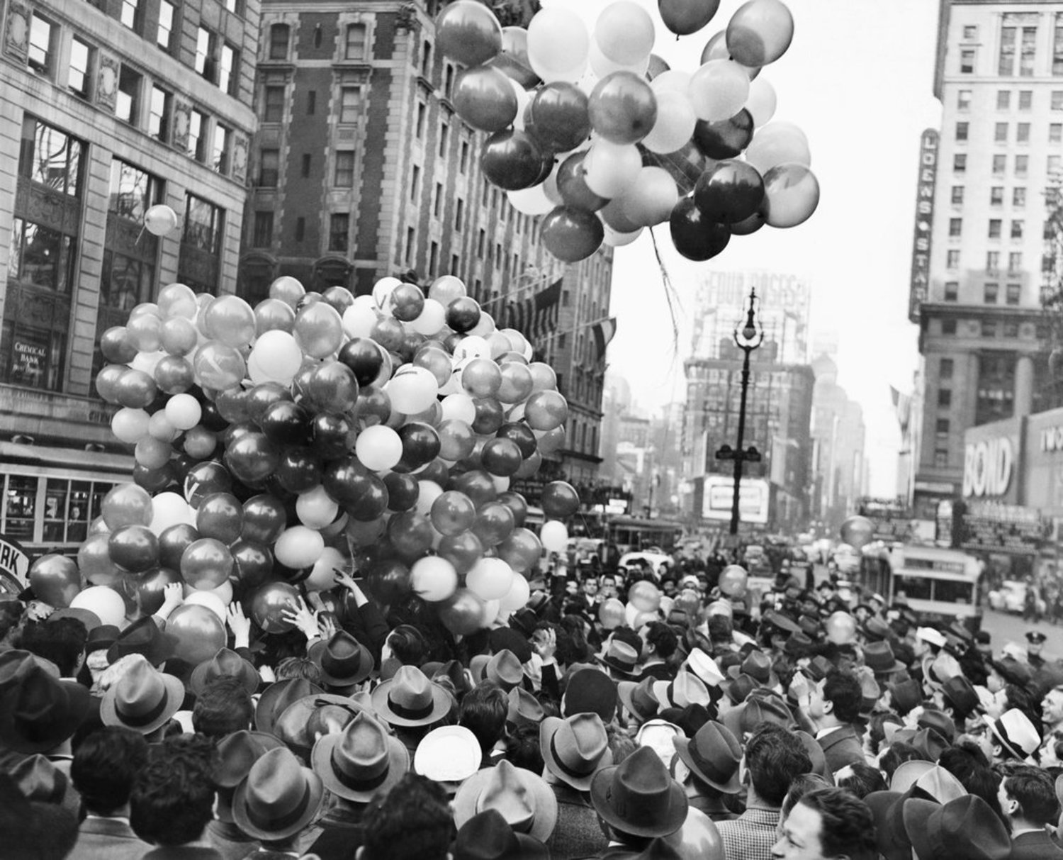 "April 22, 1942: Red, white and blue balloons were toted into Times Square as part of a U.S.O. spectacle hosted by the vaudeville comedian duo Ole Olsen and Chic Johnson. Though the comedians made an appeal for ""adequate recreational facilities for soldiers on detached duty in remote areas,"" any air of patriotic unity dissipated as soon as the balloons were released, and ""a few pugilistically inclined spectators were restrained from wholesale grabbing by the police."""