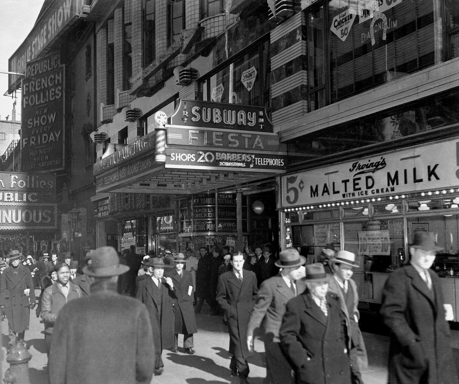 This view shows the 42nd Street subway entrance and store fronts in New York City on April 2, 1940.