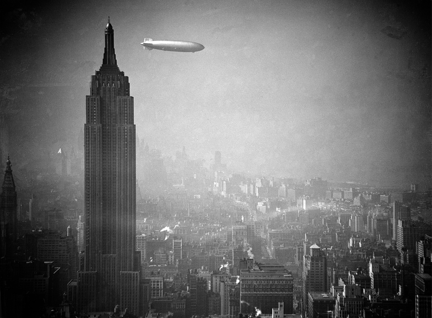 The Hindenburg flies past the Empire State Building over Manhattan on August 8, 1936, en-route to Lakehurst, New Jersey, from Germany.