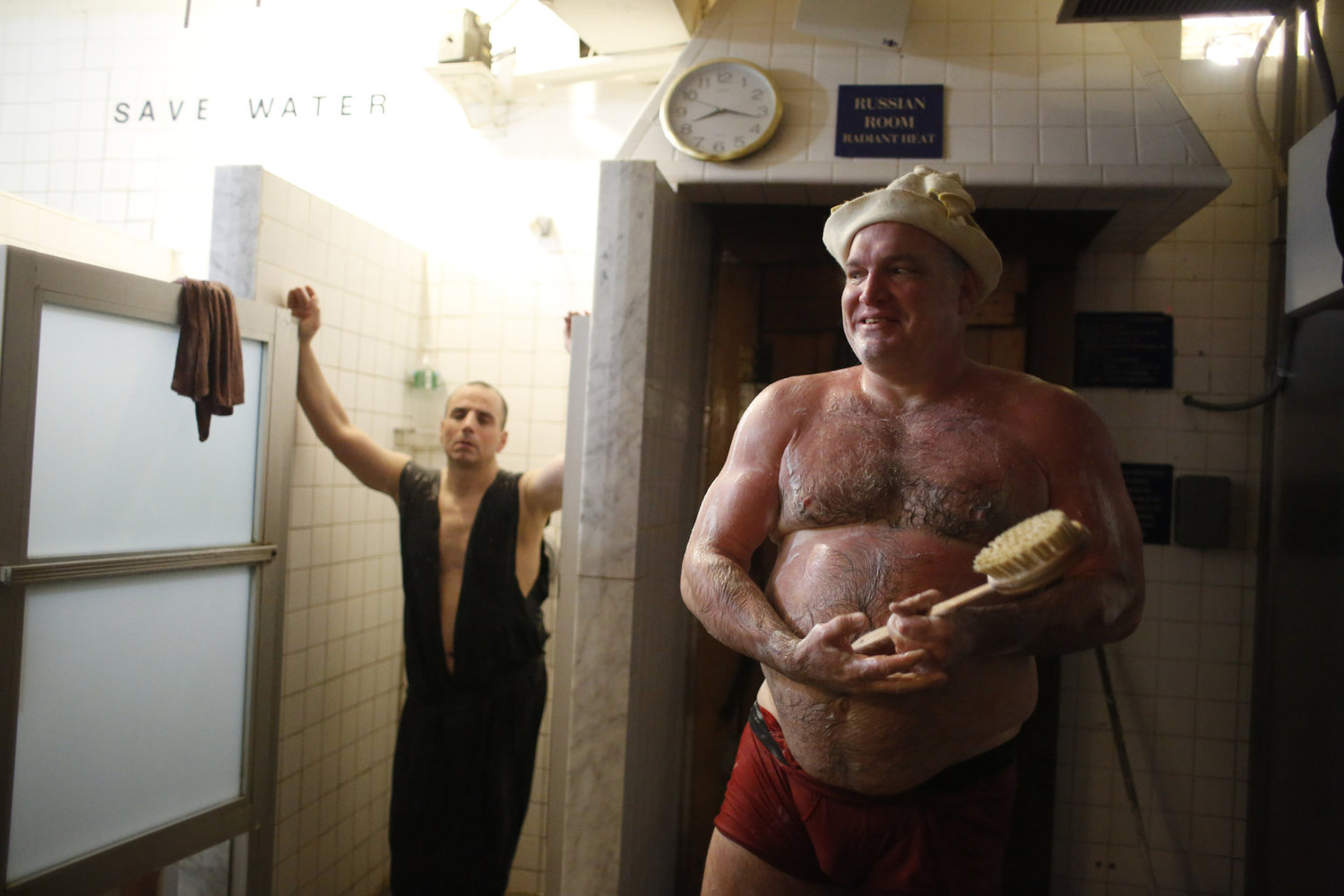 Jim Monahan scrubs down in the showers after time in the searing Russian Room, which is heated to over 190 degrees. Regulars say the saunas are hotter on so-called Boris weeks.