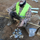 Scott Jordan with some of the find from the privy dig underneath the site of the former Bereket Turkish kebab restaurant.