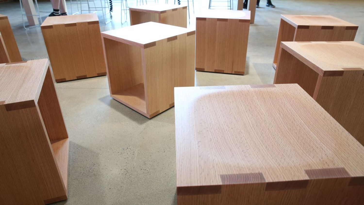 Customer seating is a series of wooden cubes.