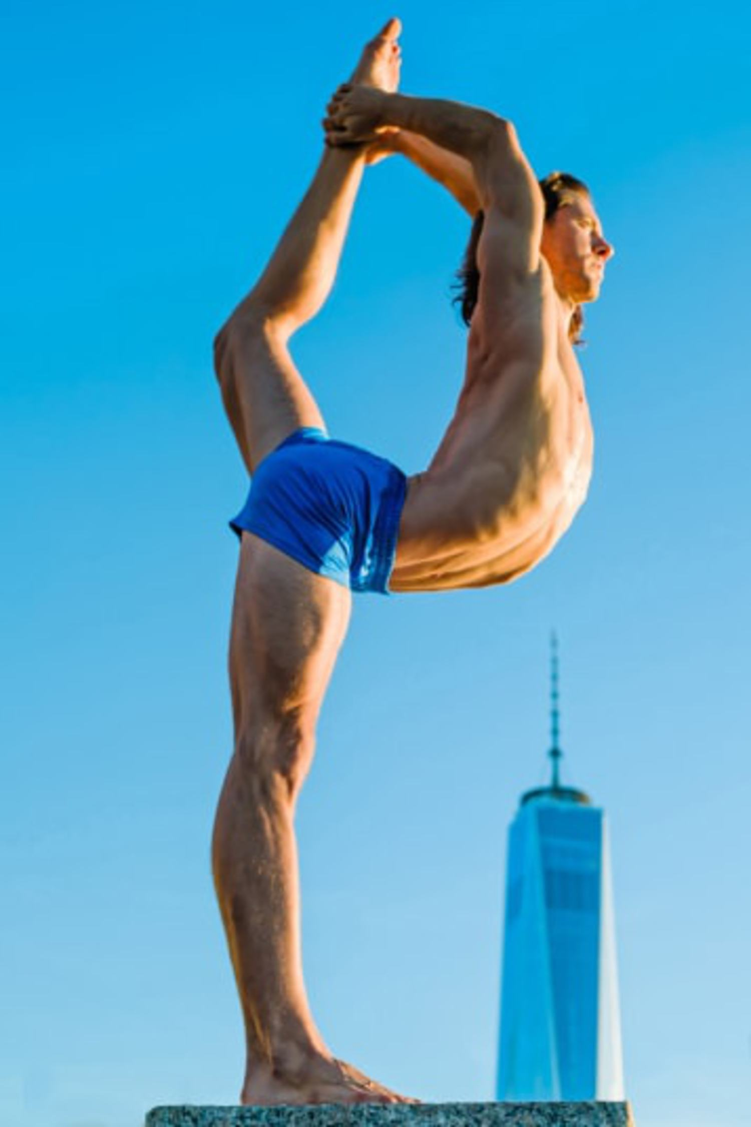 Performing yoga with the One World Trade Center in New York as a backdrop