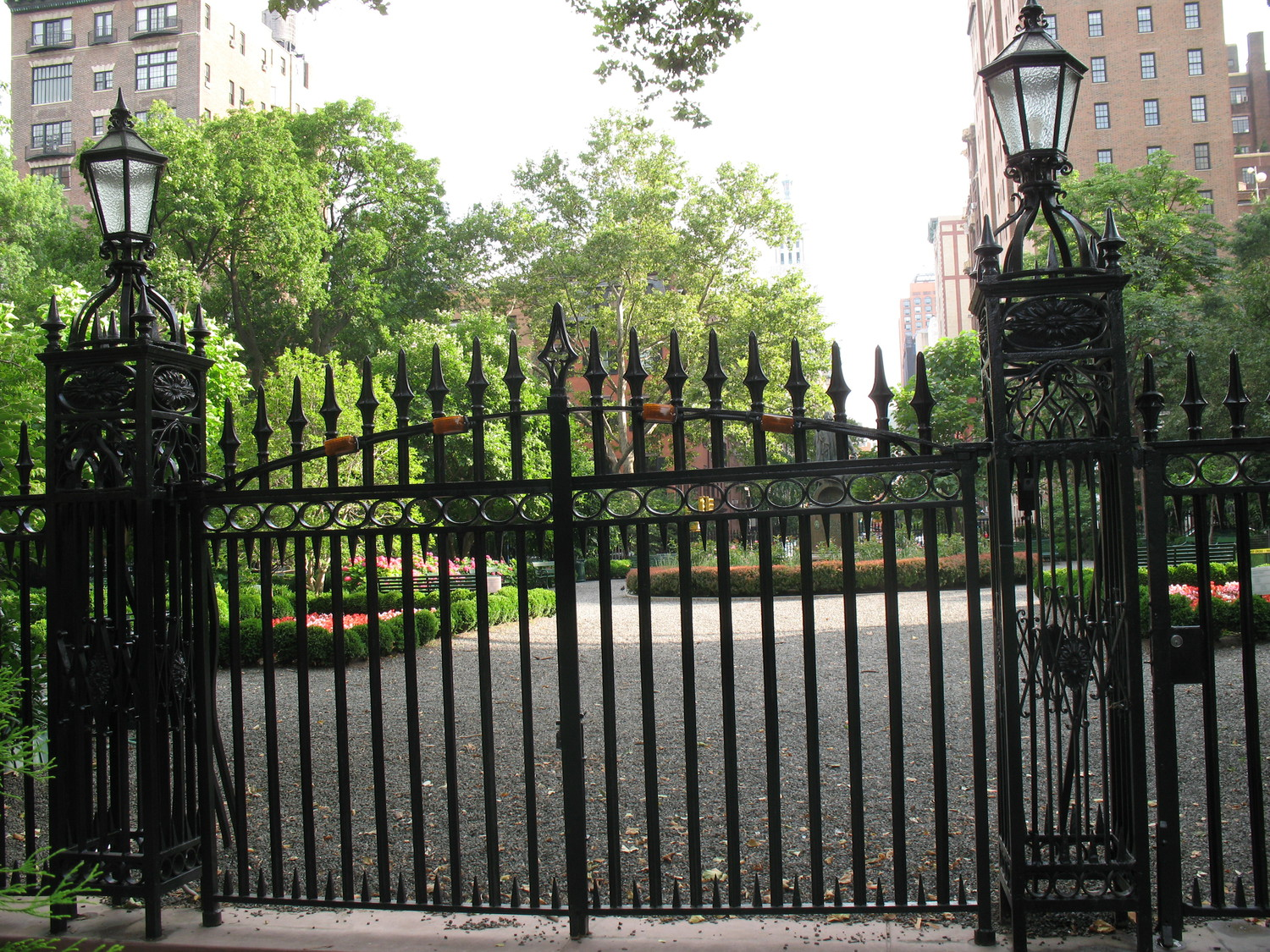 "NYC:  Gramercy Park | Gramercy Park (sometimes misspelled as Grammercy) is a small, fenced-in private park bounded by E 20th St, E 21st St, Park Avenue S, and 3rd Avenue, in Gramerce. Normally accessible only to residents of certain townhouses in the area who have keys to the park, nearby residents may buy visiting priviliges and it is open to the public on Christmas Day, Yom Kippur and Gramercy Day (which chanes early, but is often the first Saturday in May). It is the only remaining private park in Manhattan.  The name ""Gramercy"" is almost certainly a corruption of the Dutch word ""krom mesje,"" or ""little crooked knife,"" the name of a small brook that flowed along what is now 21st Street. The area was originally a swamp when Samuel B. Ruggles bought it from James Duane and turned it into part of Gramercy Farm. In 1831 Ruggles donated the property to the city on condition that no commercial enterprise be permitted on the facing streets or in the park proper. To this day, the park contains no amusements, swing sets, snack shops or any other intrusions on its rusticity.  The center of the park contains a statue of one of the area's most famous residents, Edwin Booth. Booth was one of the great Shakespearean actors of 19th century America, as well as the brother of John Wilkes Booth, the assassin of Abraham Lincoln."