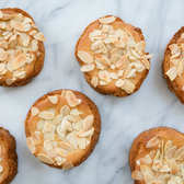 Bostock, twice-baked brioche flavored with orange-blossom water and layered with frangipane and toasted almonds.