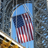 George Washington Bridge - 2008 Veterans Day | The George Washington Bridge is home to the world's largest free-flying American flag. The flag, which is located under the upper arch of the New Jersey tower, drapes vertically for 90 feet and flies freely, responding to breezes from the Hudson River or Palisades. The flag's stripes are approximately 5 feet wide and the stars measure about 4 feet in diameter. Weather permitting, the flag is flown on the following eight holidays: Martin Luther King, Jr. Day, Presidents Day, Memorial Day, Flag Day, Independence Day, Labor Day, Columbus Day, and Veterans Day [Source: The Port Authority of New York and New Jersey]