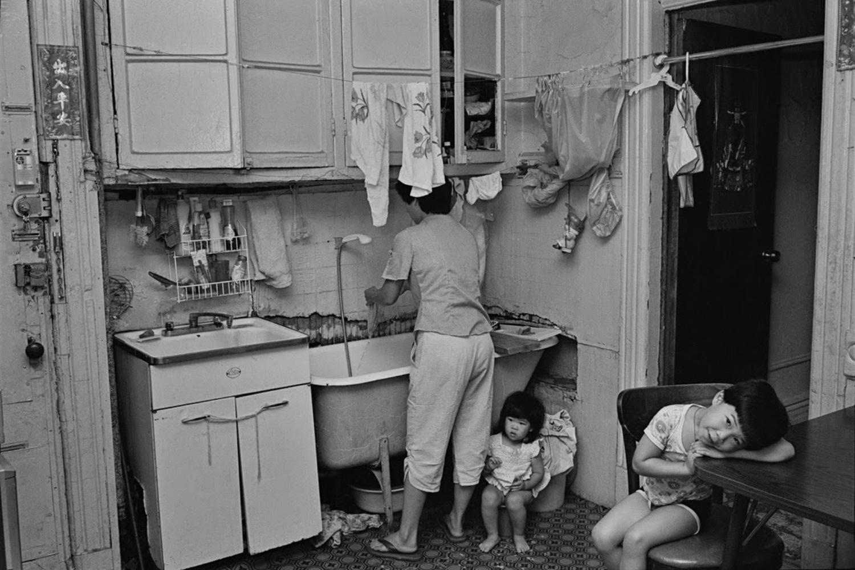 Rebecca with her children in their kitchen, 1982.