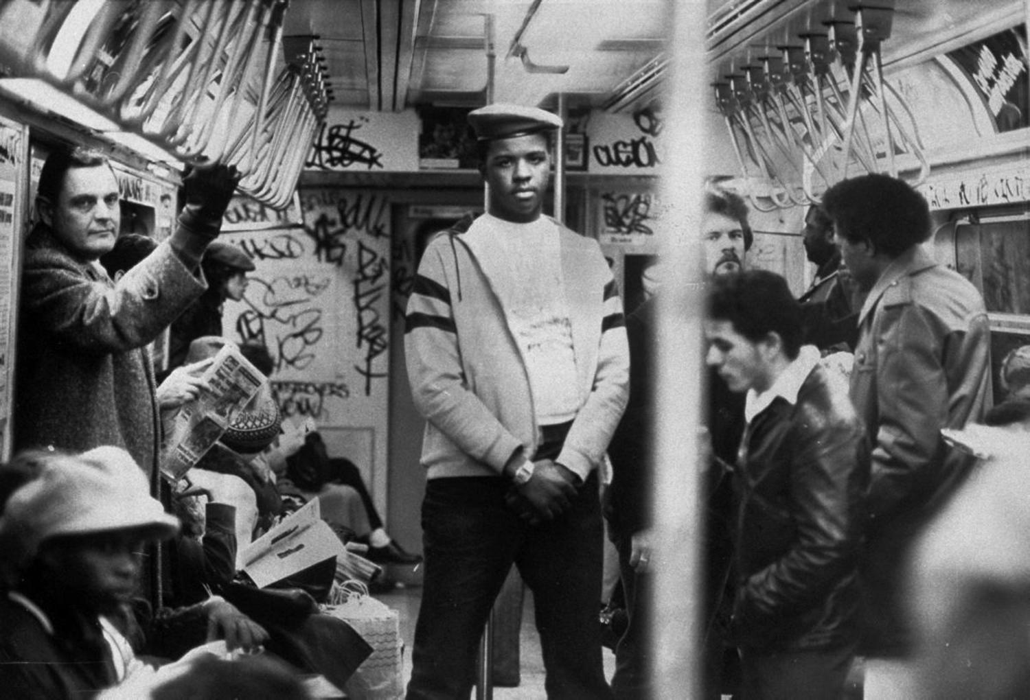 1980's: A member of the volunteer crime-fighting organization, the Guardian Angels, patrols a subway car in the 1980s. The organization was both praised and vilified by the media for its efforts.