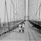 Pedestrians on the upper deck promenade of Brooklyn Bridge