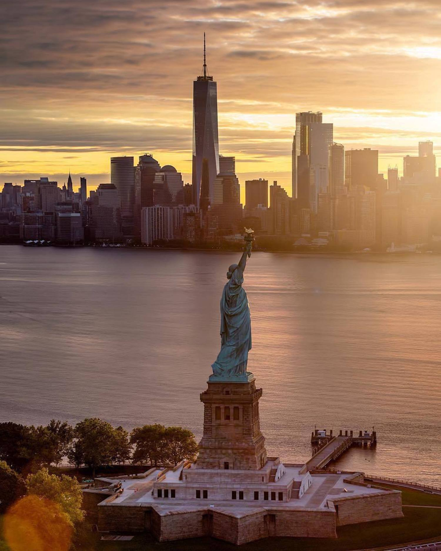 Statue of Liberty, New York, New York. Photo via @beholdingeye #viewingnyc #nyc #newyorkcity #newyork #statueofliberty #sunrises