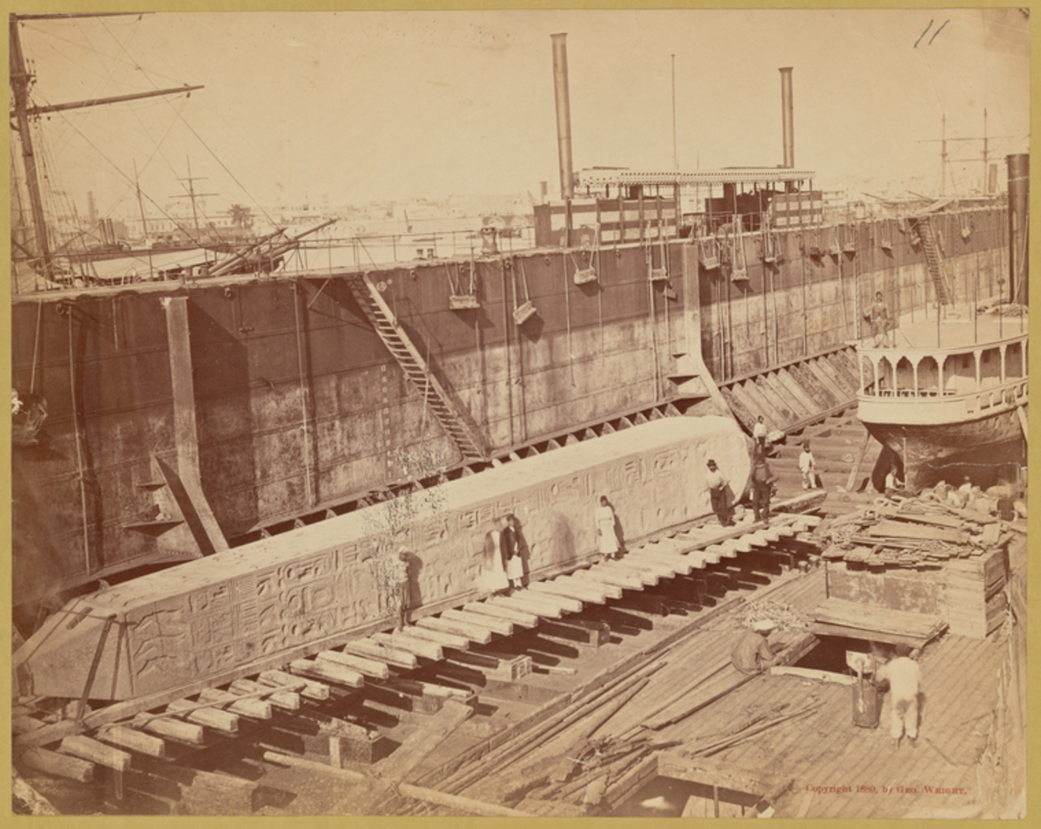 "The obelisk ""Cleopatra's Needle,"" not yet crated, on ramp in dry dock prior to being loaded onto ship ""Dessoug"""