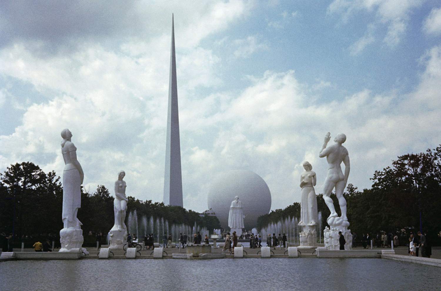 A row of statues leads to the Perisphere and Trylon.