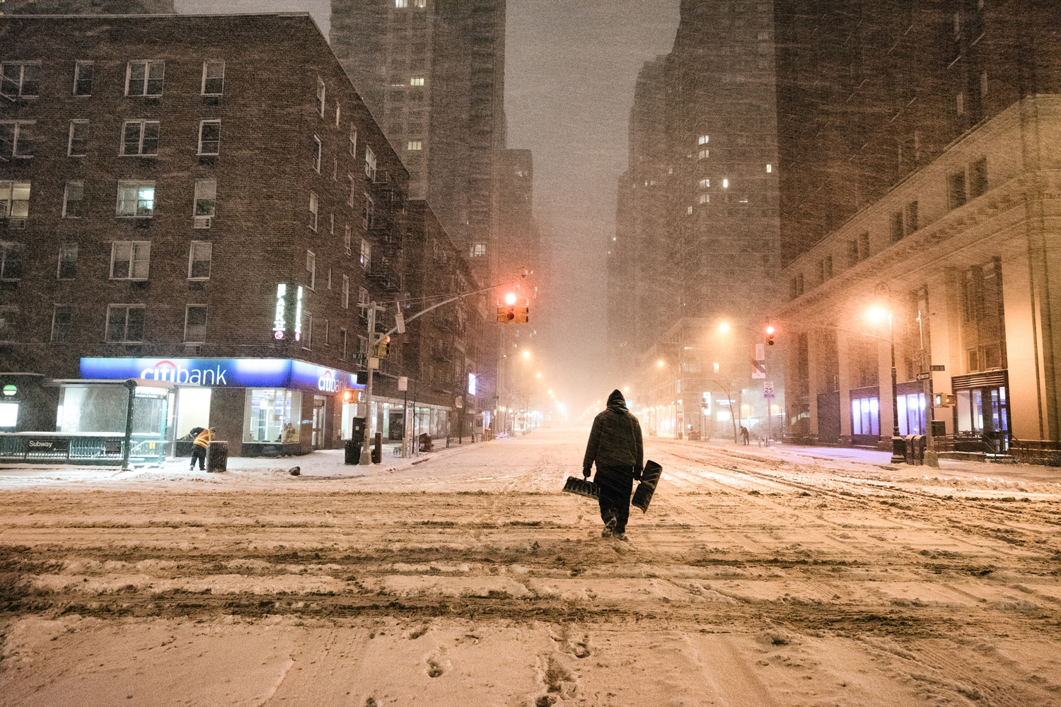 "New York City - Snow - Winter Storm Juno - Empty 6th Avenue | Juno: The first snowstorm of 2015 in New York City.  ---  (Note: My <a href=""http://www.amazon.com/gp/product/1440339589/ref=as_li_tl?ie=UTF8&camp=1789&creative=9325&creativeASIN=1440339589&linkCode=as2&tag=nyththle0e-20&linkId=ER6GYT5FRYNMEPLF"" rel=""nofollow"">New York photography book</a> released worldwide in stores/online recently and has photos similar to this  [full info below])  ---  I have been photographing New York City during snowstorms at night for the past 5 years. When it comes to experiencing <a href=""http://nythroughthelens.com/tagged/snow"" rel=""nofollow"">New York City in the snow</a>, I relish the challenge. The more gusty, snowy, and brutal the storm, the more of a chance that I will be out in it traipsing around New York City with my cameras in tow.  When I heard that the MTA was suspending all transit service (and most vehicles) at 11 pm, I made the decision to take the train up to the Upper East Side prior to 11 pm to deposit myself up there with the intention of walking from the Upper East Side to Times Square and then walking the several miles back to the Lower East Side (whew!!).  The streets were eerily empty.  Emptier than they are usually at night during snowfall. Since there was a ban on all vehicles aside from snow plows and emergency services, there were practically no cars at all on the streets. Even taxis were banned from the streets!  I walked in the middle of avenues and streets that are usually teeming with cars.  There was an eerie sense of calm.  It was magical.   ---  This is part of a post that I posted to my NYC photography blog. If you are curious enough to look at the photos there, here is the link to the post:  <a href=""http://nythroughthelens.com/post/109291619025/new-york-city-snow-winter-storm-juno-i"" rel=""nofollow"">New York City - Winter Storm Juno</a>   ----  * As mentioned above - My New York City coffee table book that released in stores/online worldwide recently.   Tons of information about my <a href=""http://www.amazon.com/gp/product/1440339589/ref=as_li_tl?ie=UTF8&camp=1789&creative=9325&creativeASIN=1440339589&linkCode=as2&tag=nyththle0e-20&linkId=ER6GYT5FRYNMEPLF"" rel=""nofollow"">New York photography book</a> with sample pages (including where to order and what stores are carrying it) here:  <a href=""http://nythroughthelens.com/post/92873566010/ny-through-the-lens-the-book-i-am-super"" rel=""nofollow"">NY Through The Lens: A New York Coffee Table Book</a> ---   View my New York City photography at my website <a href=""http://nythroughthelens.com/"" rel=""nofollow"">NY Through The Lens</a>.  View my Travel photography at my travel blog: <a href=""http://travelinglens.me/"" rel=""nofollow"">Traveling Lens</a>.  Interested in my work and have questions about PR and media? Check out my:  <a href=""http://nythroughthelens.com/about"" rel=""nofollow"">About Page</a> 