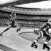 "May 26, 1973: A roller derby triple-header at Shea Stadium involved contests between the Chiefs and the Bombers, the Pioneers and the Jolters, and finally the Chiefs and the Pioneers, in which the Chiefs prevailed. In this photo, a Jolter, left, struggled to keep his balance as Bob Hein of the Pioneers rolled past. ""The fans hate me,"" said Hein, who played with a broken cheekbone protected by a mask. ""He had a fight and was penalized for 'slugging,'"""