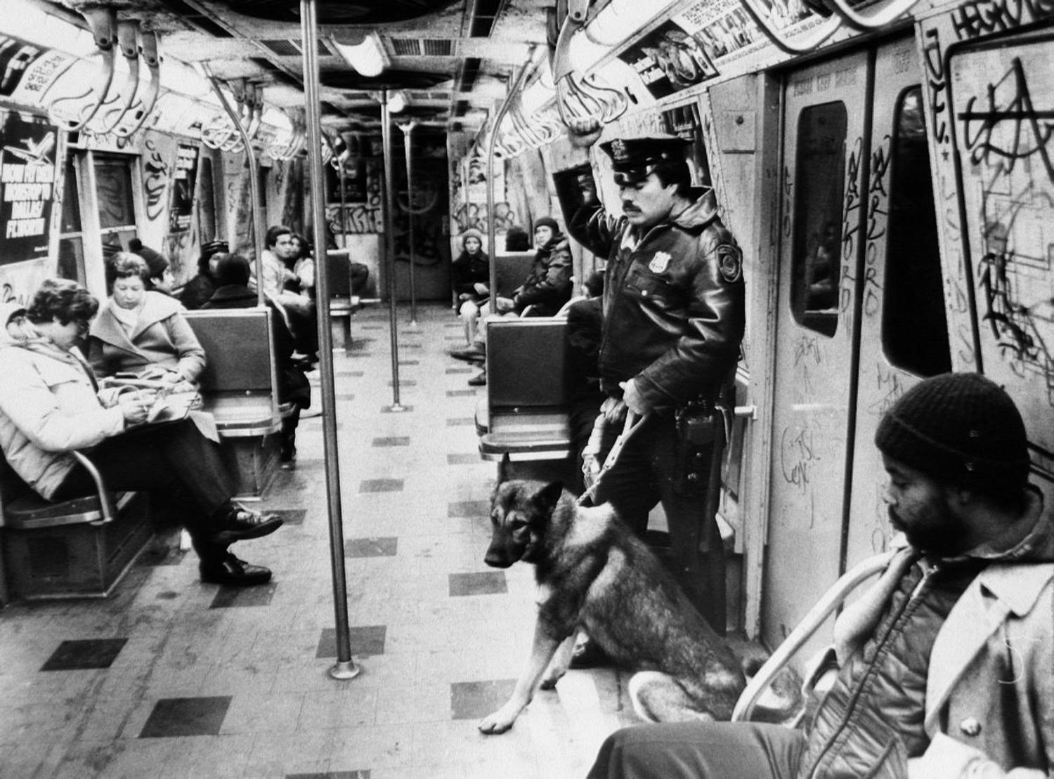 1980's: Transit police officer Emilio Mesa and police dog Blitz ride a graffiti covered subway car.