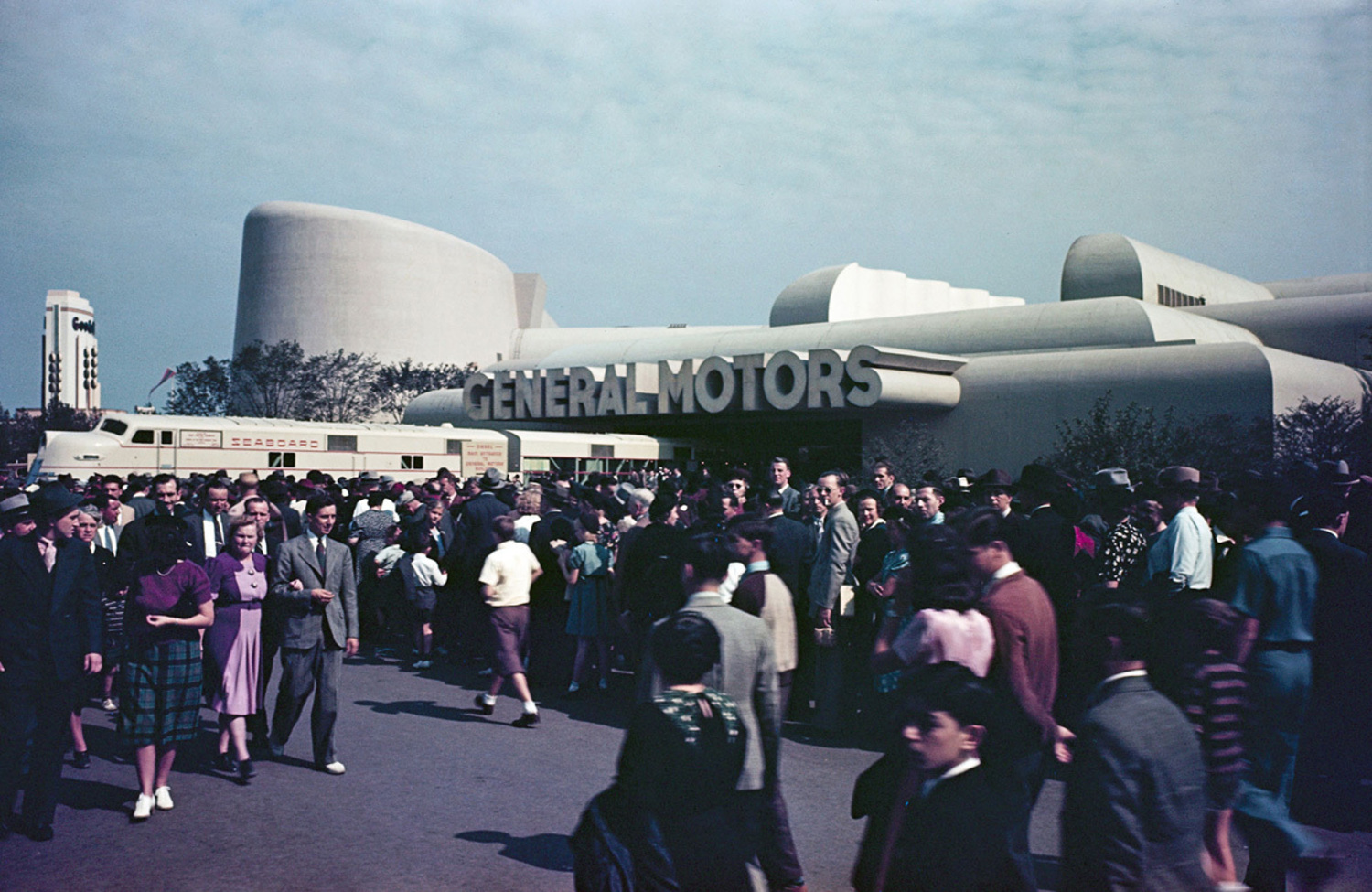 A large crowd in front of the General Motors Pavilion.