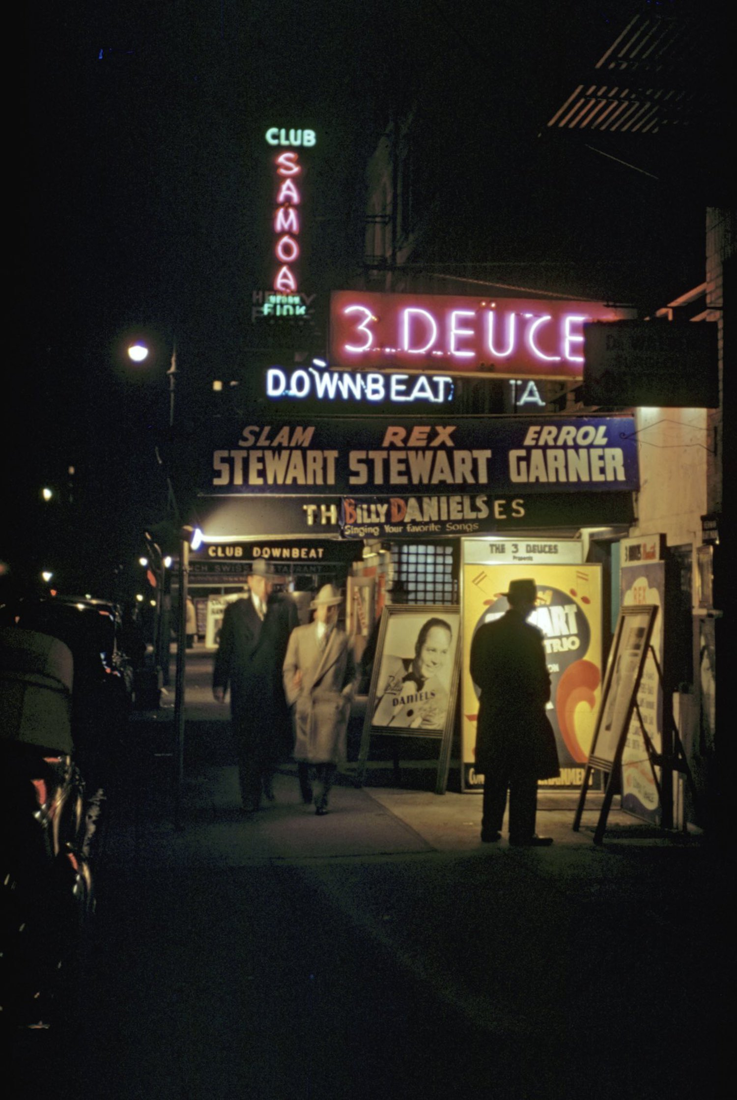 1946 Tourists wander past Club Samoa, Club Downbeat and 3 Deuce in Times Square.