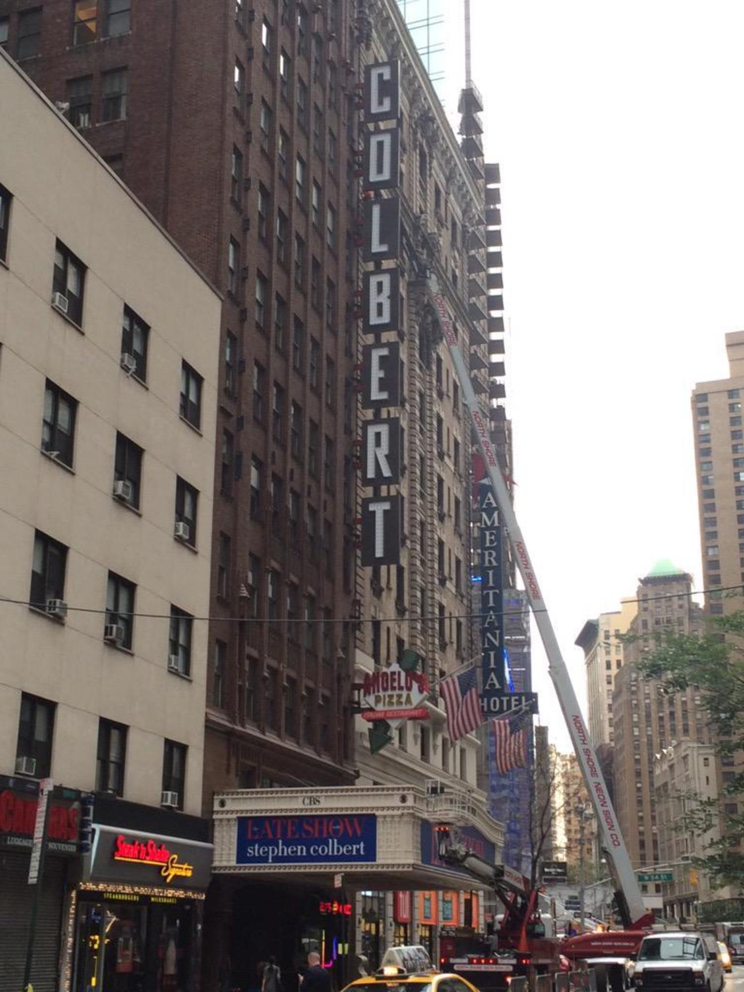 Sign guys at Ed Sullivan Theater currently affixing giant neon COLBERT letters to the building http://t.co/0MuOqn2rVl