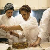 Refugee chefs with Eat Offbeat prepare a meal