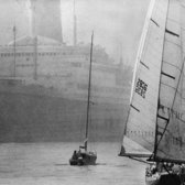 "October 16, 1971: Sea vessels both huge and minuscule passed each other in New York harbor in the lead-up to the Mayor's Cup schooner race. The enormous ship at the left and the tiny one in the middle did not compete (schooners have two or more masts) in the competition, which is held in October for its brisk winds and clear air. ""Today did not oblige,"" reported The Times. ""For those in the spectator fleet, the full length of the starting line was barely visible through the fog."""
