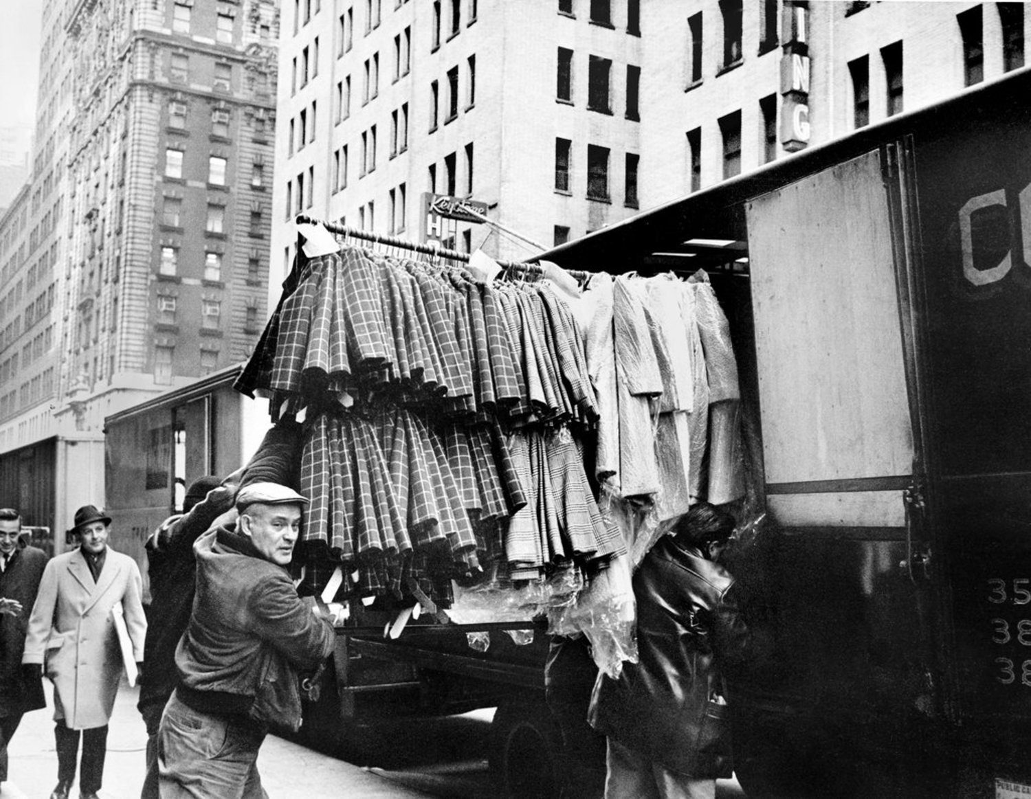 "Jan. 31, 1967: Unloading garments in Manhattan's ""congested, busy streets (where one worker barely dodged a group of converging handtrucks last week and said, bitterly, 'Kind of like a snake pit')."" The Times reported on the challenges confronting the fabric industry, whose smaller producers ""supply the nuts and bolts of the garment industry — the buttons, the linings, zippers, trimmings, machines, the trucks and even the sandwiches — and what is more important?"""