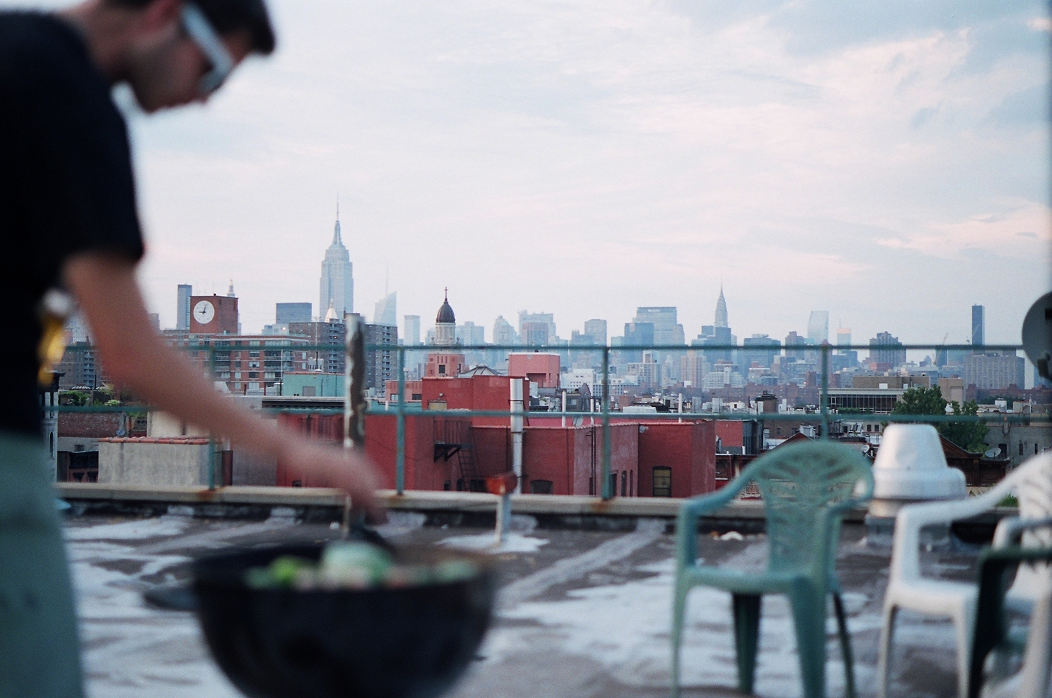 "BBQ at The Awsome House | My rooftop's view over NYC's skyline.  Camera: Minolta SRT-102 Lens: MC Rokkor-PF 1.7 55mm Film: Fujifilm Pro 400H  Listen: <a href=""http://www.youtube.com/watch?v=6QaFK_GvO_s"" rel=""nofollow""><b>The Walkmen - Heaven</b></a>"