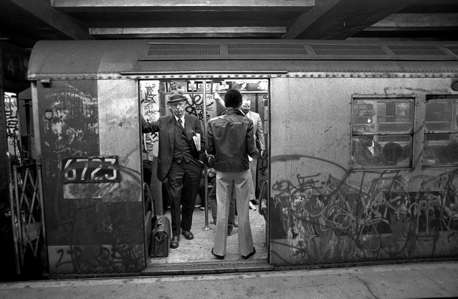 1980's: Subway riders head to work on a dirty, graffiti-covered train along the Lexington Avenue line in 1981.