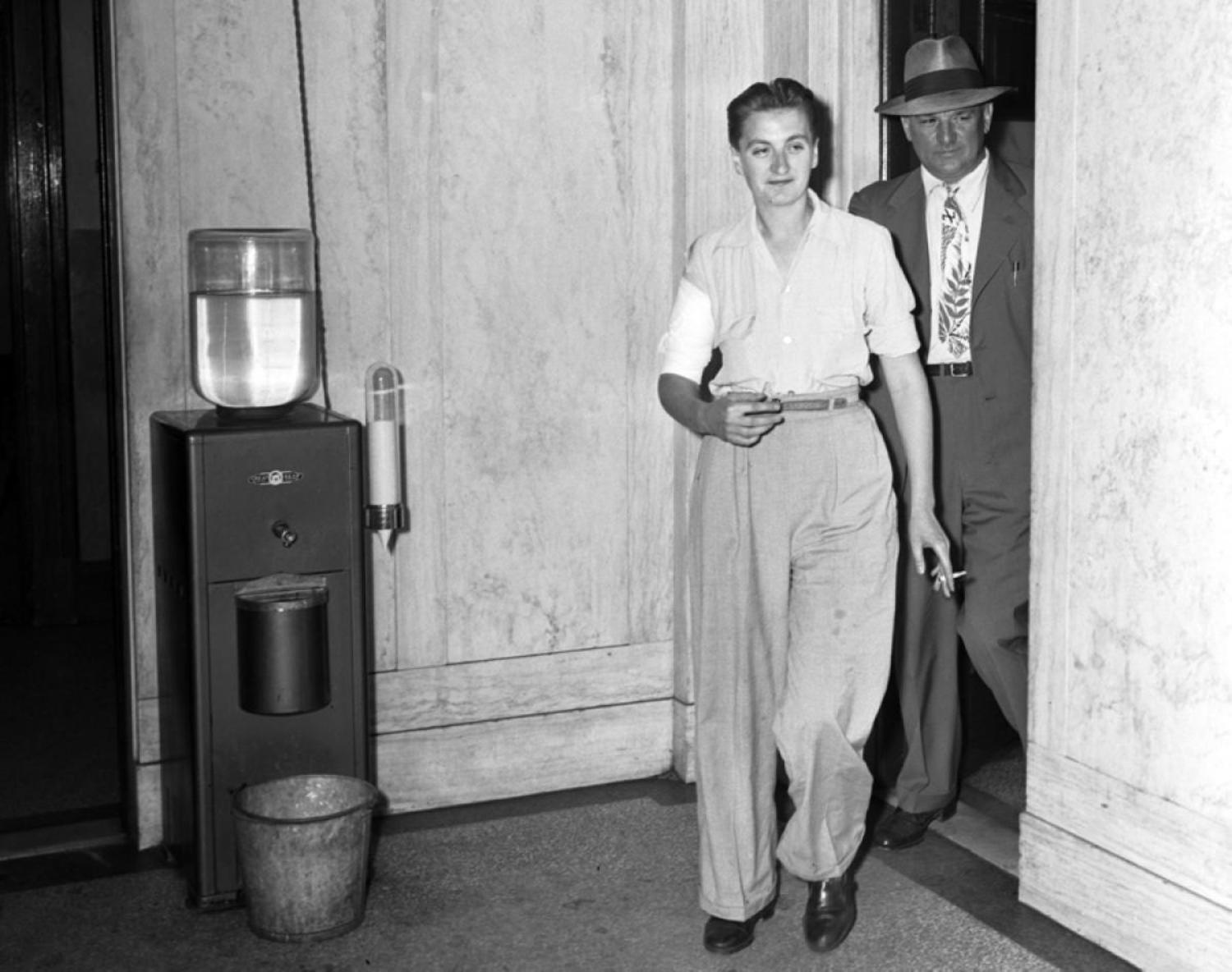 Mob Moll, 1943: Mary Duke could pass for a male gangster! The mob moll was clad in baggy slacks as she arrived at Newark police headquarters, with her right arm bandaged, after being arrested following a gun duel in 1943.