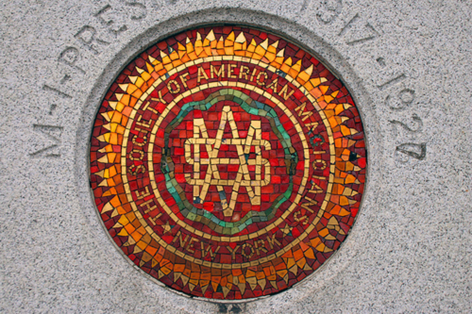 The Society of American Magicians' emblem on Houdini's monument.