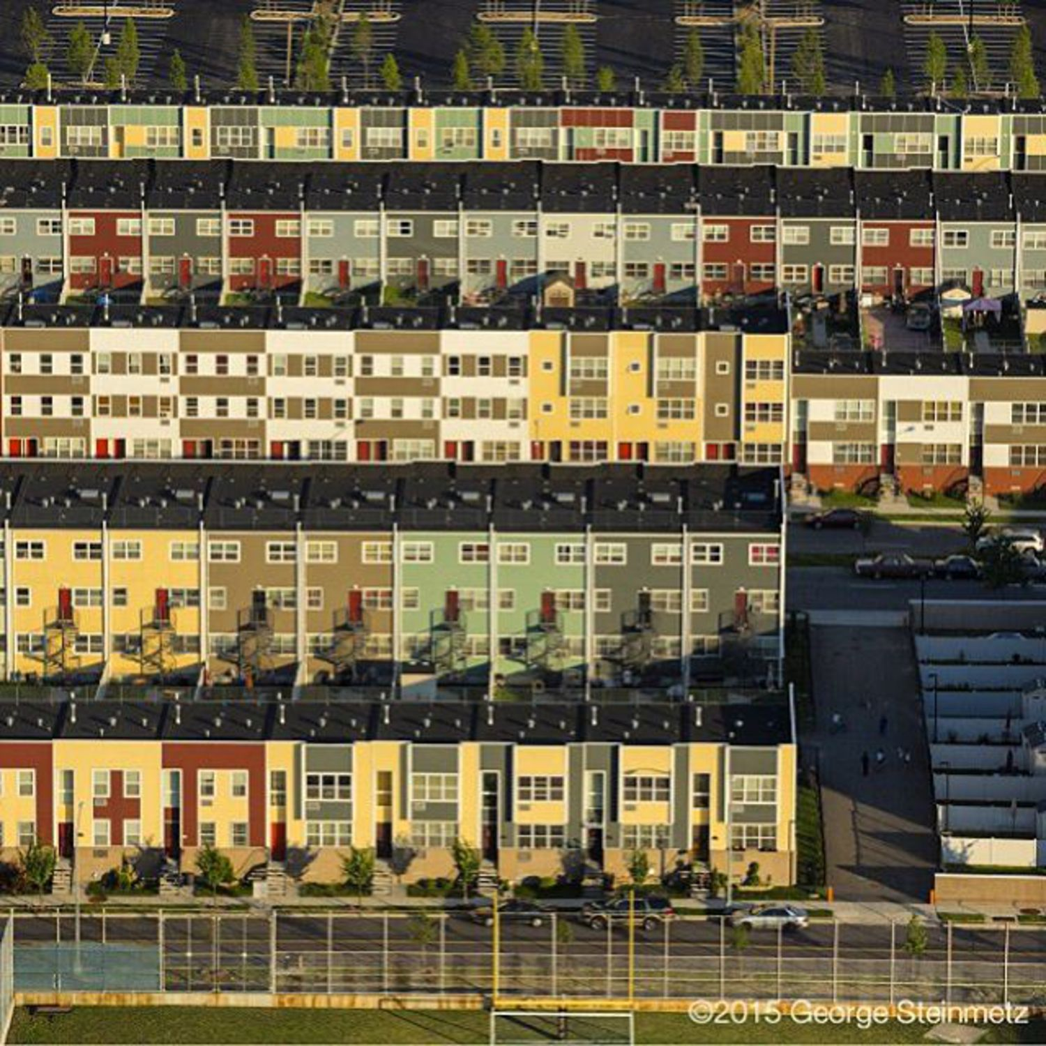 Photograph by George Steinmetz @geosteinmetz / @thephotosociety One of the NYC's newest neighborhoods, Spring Creek Nehemiah is home to 233 first-time homeowners who won a lottery sponsored by the city.  Located in Brooklyn's East New York, it is composed of prefabricated one-, two- and three-family homes assembled at the Brooklyn Navy Yard. Homeowners put down as little as $8,000 to purchase their houses, which ranged in price from $158,000 to $488,000.