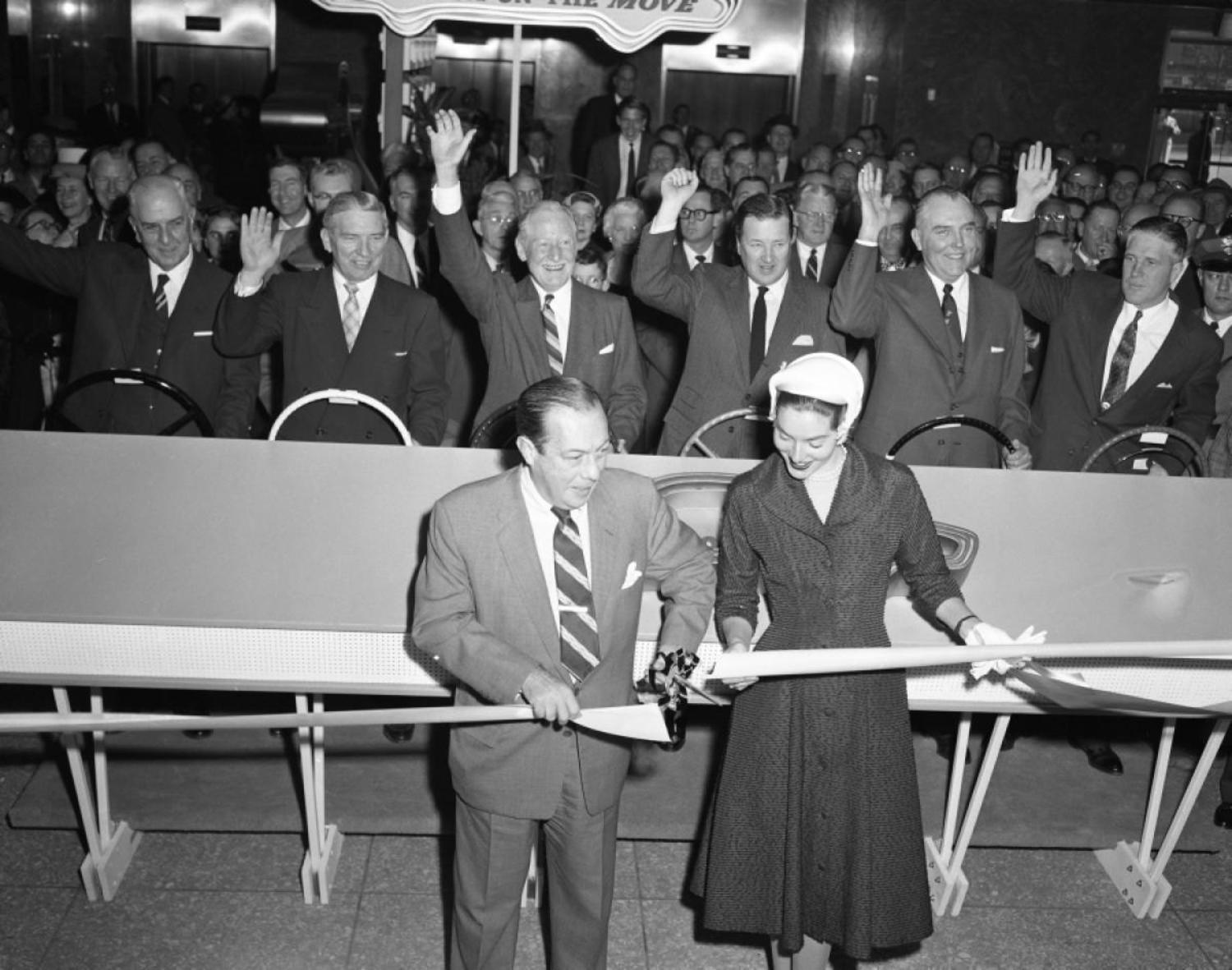 The ribbon is cut, let the show begin! New York Mayor, Robert Wagner, gets a little help from Lee Ann Meriwether, a former Miss America, to help usher in the 1957 auto show.