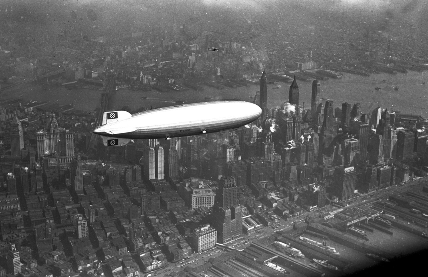 The German zeppelin Hindenburg flies over Manhattan on May 6, 1937.