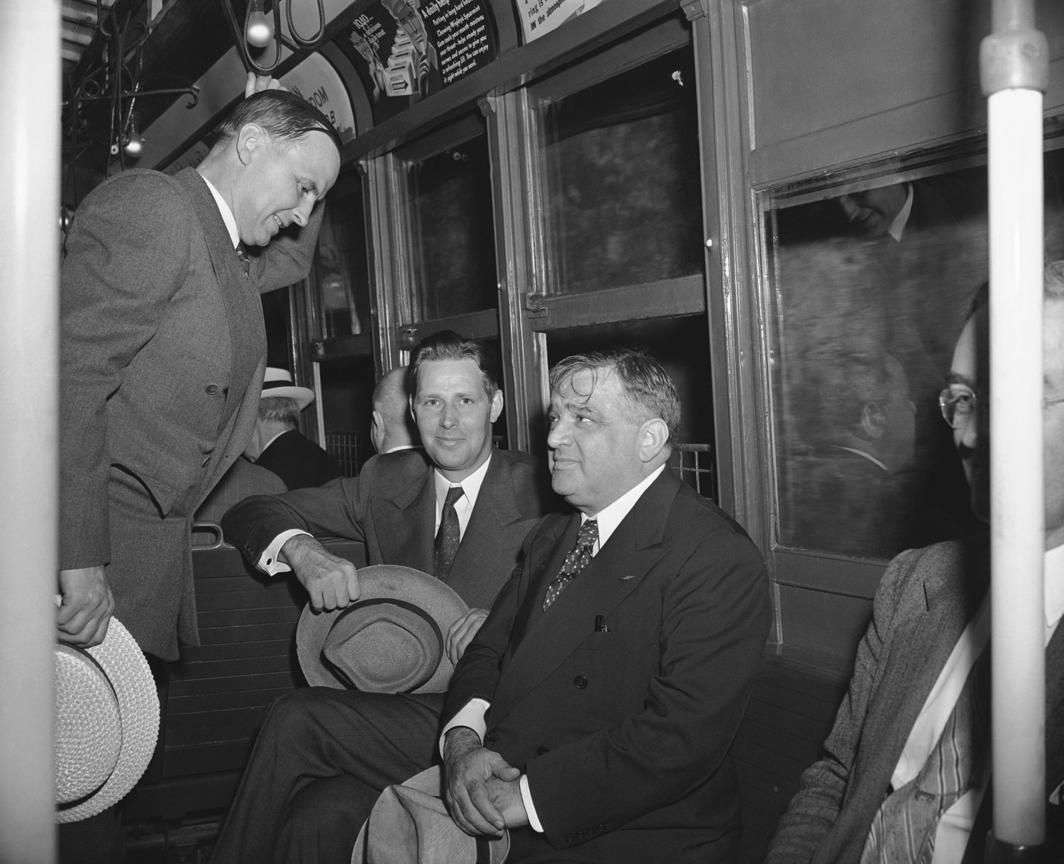 Mayor John F. Carr of Medford, Mass., Mayor Maurice J. Tobin of Boston, and Mayor Fiorello La Guardia of New York, left to right, take a subway to go from City Hall to their hotel for lunch in New York, Aug. 5, 1942, after conferring with mayors of Atlantic Coast cities on gasoline and fuel problems for the northeast.
