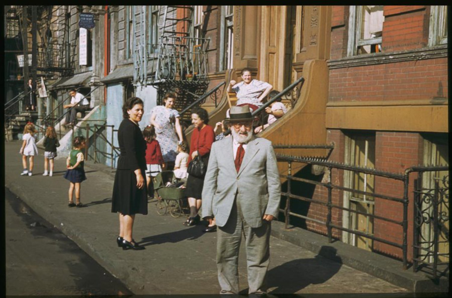 Residents socialize on Clinton Street on Manhattan's Lower East Side on a Saturday afternoon.
