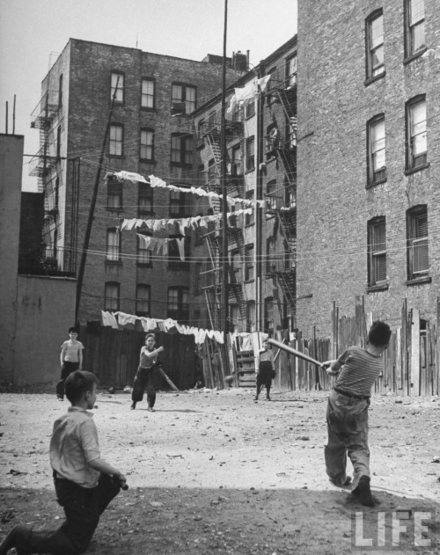 Vintage Photograph Of Young Boys Playing Stickball In A