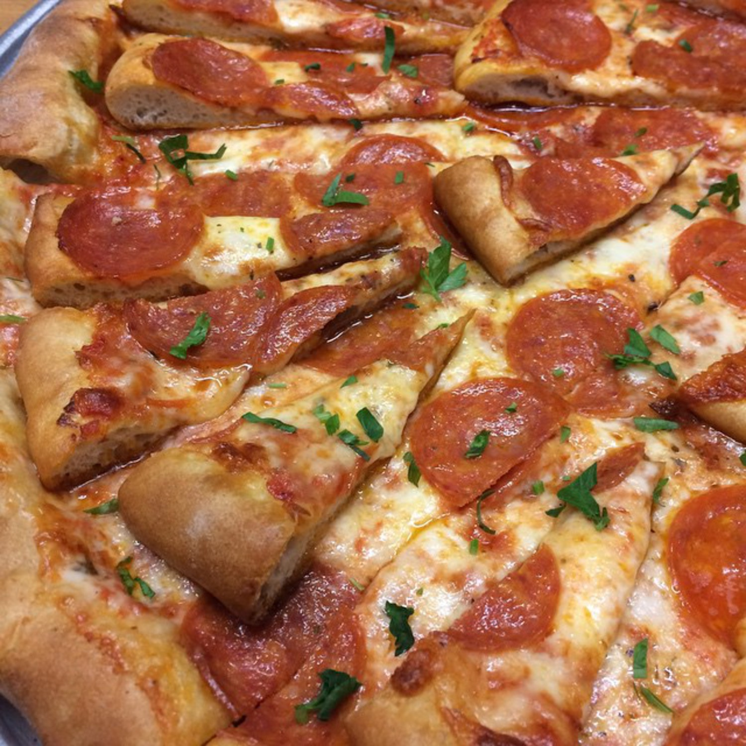 The InPEPtion, mini slices of pepperoni pizza topped on slices of pepperoni pizza, today at Vinnie's Williamsburg! #minivinnie #pizzaonpizza #vinniespizzeria