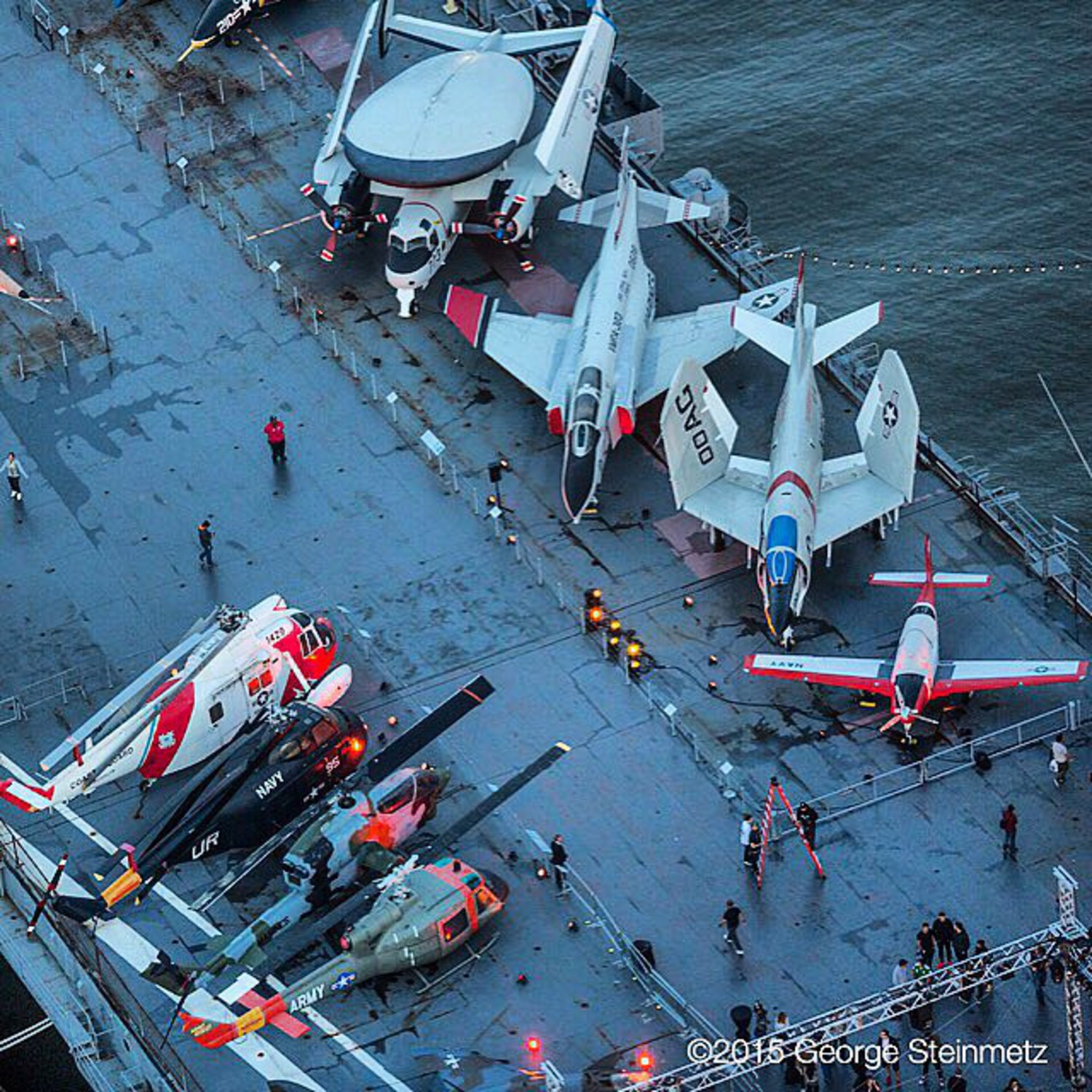 Photograph by George Steinmetz @geosteinmetz / @thephotosociety  The flight deck at the USS Intrepid, a WW2 era aircraft carrier, that was converted into a Sea, Air & Space Museum in New York City with a heavy dose of generosity from real-estate developer Zachary Fisher.