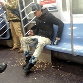 Asshole throwing nuts onto NYC Subway Floor