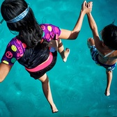 Kids leap into the water