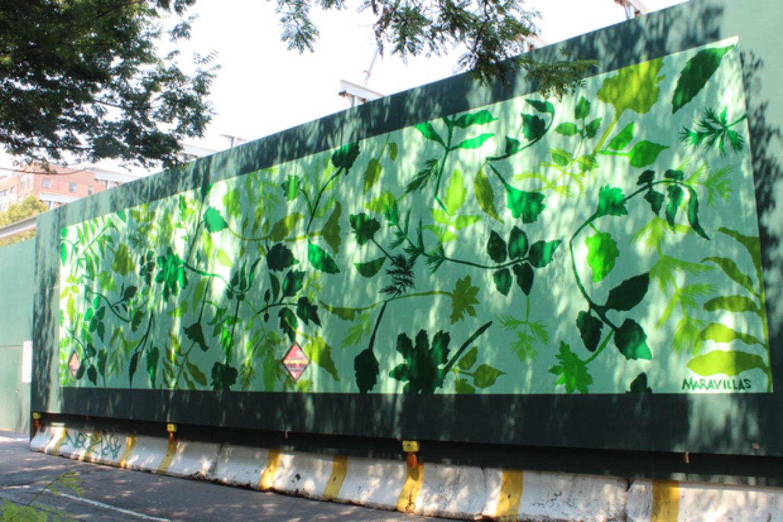 Artist Jennifer Maravillas created a mural depicting lush foliage.